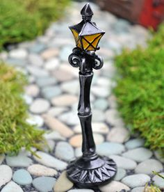 Fiddlehead Fairy Miniature Lamp Post  (miniature)  http://www.efairies.com/store/pc/Fiddlehead-Fairy-Miniature-Lamp-Post-103p7301.htm  $3.95
