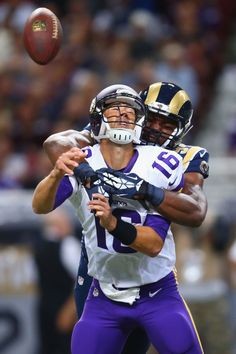 Robert Quinn of the St Louis Rams sacks Matt Cassel of the Minnesota Vikings at…