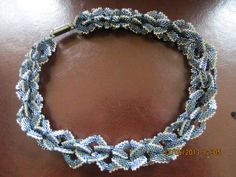 #30  Another links with magnetic closure.  It's not a choker.  It falls right at the clavicle