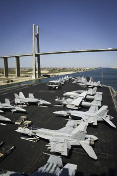 SUEZ CANAL (Oct. 20, 2013) The aircraft carrier USS Nimitz (CVN 68) passes under the Freedom Bridge as the ship transits the Suez Canal. The Nimitz Carrier Strike Group is deployed to the U.S. 5th Fleet area of responsibility conducting maritime security operations and theater security cooperation efforts. (U.S. Navy photo by Mass Communication Specialist 3rd Class Raul Moreno Jr./Released)