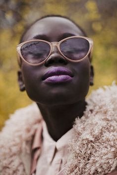 Jacqueline Harriet glowing skin, lavender lips. I like her glasses and her flawless skin!