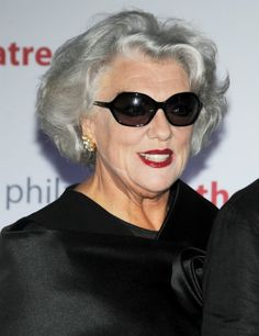Tyne Daly Not long hair but she is rockin' that gray. I always thought she was a wonderful actress and has a lot of class.
