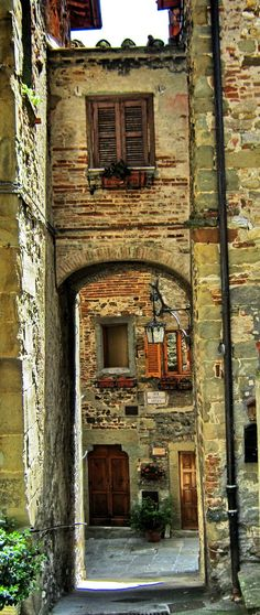 Anghiari, province of Arezzo, Tuscany, Italy--- The texture and color on this old building is lovely.