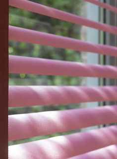"""Super-sleek and always stylish, Luxaflex® Venetian Blinds offer excellent light control and privacy in a classic style that works with every décor. Made with highly resilient aluminium slats that won't lose their shape, our Venetian Blinds have a built in """"bounce back"""" feature. This pink venetian blind is also available in a kaleidoscope of other fashionable colours."""