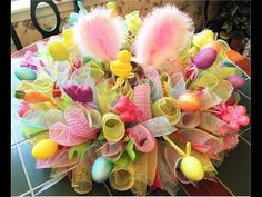 Dollar Tree Easter Wreath: EZ Do-it-Yourself DollarTree Supplies make it a bargain! - YouTube Easter Centerpiece, Deco Mesh Wreaths, Center Pieces, Easter Ideas, Centerpieces, Table Centerpieces, Mesh Wreaths, Table Decorations, Floral Centerpieces