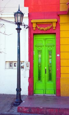 Bright pink and green door. Bold Color. Statement entry way.