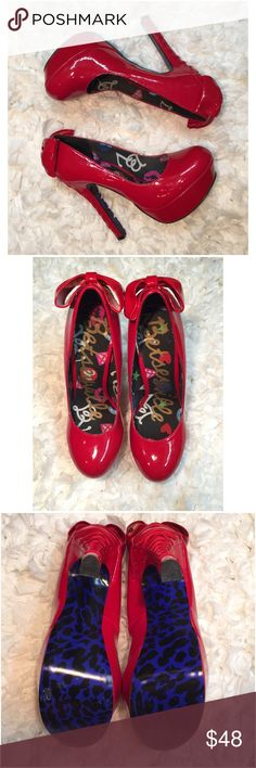 Red Betsey Johnson Corset Heels w/Bow. Size 8 Gorgeous Betsey Johnson Corset Heels with Bow! Never worn. Bottom of one shoe has a little part of the leopard rubbed off from bumping against other shoes in closet. Betsey Johnson Shoes Heels