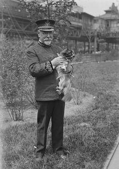 John Philip Sousa holding a dog.