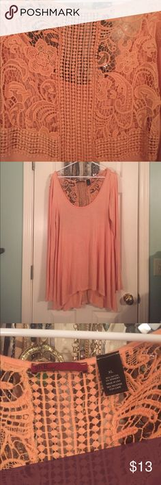 BKE red peach long sleeve Tunic This is a long sleeve Tunic with a slip up the back about 7 inches. The top is 95% rayon and spandex. It is extremely soft and comfortable. The back is extremely beautiful with all the details. BKE Tops Tunics