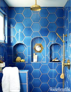 "Shampoo storage never looked so chic. In Justina Blakeney's ""Jungalow,"" the shower's niche is inset with a vintage mirror. Adriatic Sea hexagonal tiles are by Fireclay Tile. Bad Inspiration, Bathroom Inspiration, Bathroom Ideas, Gold Bathroom, Bathroom Designs, Bathroom Colors, Shower Designs, Bathroom Shelves, Bathroom Remodeling"