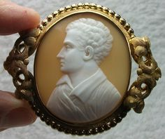 """""""Lord Byron""""  —Sardonyx shell, 18k gold, 1850/60 Italy (frame could be English). Cameo depicting a rare subject: George Gordon Byron, 6th Baron Byron; later George Gordon Noel, 6th Baron Byron, FRS (22 January 1788–1819 April 1824), commonly known simply as Lord Byron. Lord Byron was a British poet and a leading figure in Romanticism. The frame is stunning, too—very elaborate to complete this very """"simple"""", museum quality cameo."""