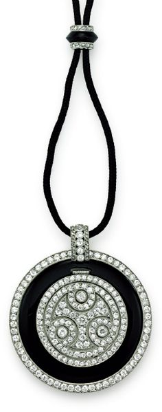 An Art Deco diamond and onyx pendant watch, by Cartier, circa 1925. With…