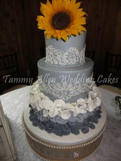 Tammy Allen Premier Wedding Cakes - Houston Cakes -   Gray fondant-frosted wedding cake with 3D sugar flowers, lace design and sunflower topper