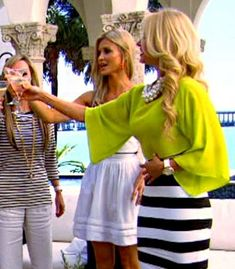 Alexia from Real Housewives of Miami had on a killer outfit on the Season 3 opener... Check out that black & white striped dress with lime green top! Amazing!