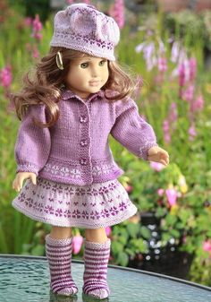 Lovely knitting pattern for your doll in 2 lilac colors  www.doll-knitting-patterns.com