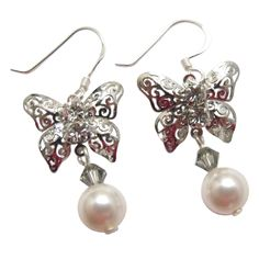 Price :$5.49 Silver Butterfly White Swarovski Pearl Black Diamond Crystals Earrings Material Used : Genuine Swarovski White Swarovski Pearls 8mm & 4mm bicone Black Diamond crystals dangling from Silver Butterfly frame earrings with sterling silver 92.5 hook  Earrings Length : 3/4 inch long