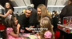 Voice coach Adam Levine is known for his slick style, but at Sunday night's 55th Annual Grammy Awards on Feb. 10, he was extra stylish when he met up with Ellen DeGeneres's protégés Sophia Grace and Rosie.   The British cuties cornered Adam and Maroon 5 bandmate James Valentine on the red carpet...
