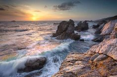 America's Best Beaches - Sunset view of waves eroding the rocky coastline near Carmel, Central Calif