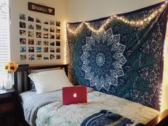 I like the decorations on the wall (tapestry, photos, wooden name thingy)