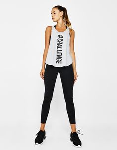 Sports T-shirt with slogan and side slit. Discover this and many more items in Bershka with new products every week