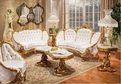 A living room decorated with furniture that is  either Baroque or Rococo