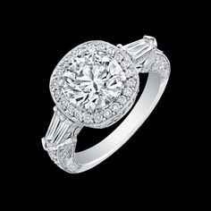 Round Brilliant Diamond set in hand engraved platinum pavé ring with wire filigree details and Tapered Baguette sidestones  Available from 0.75-3.00 carats  item# 5288