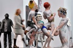 A woman passes an artwork by artist Barna Peli at the art fair in Cologne, Germany, Tuesday, April 17, 2012. Around 200 leading international galleries show and sell selected top 20th and 21st century artworks at the ART COLOGNE until April 22. AP Photo/Martin Meissner.