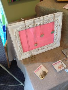 Frame with necklaces draped over