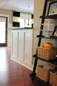 Boring Builder Bar gets a custom makeover using simple pine boards placed vertically. via The Yellow Cape Cod #diy