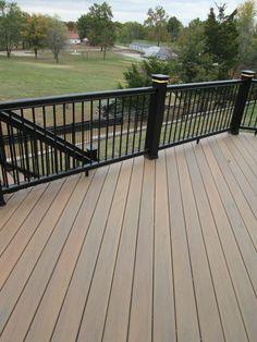 Wrought iron deck railing google search garden and for Fiberon vs trex