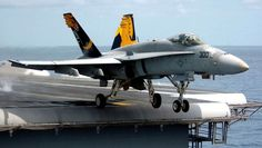 F-18 HORNET TAKES OFF FROM THE LAST TIP OF THE AIR CRAFT CARRIER RAMP - GREAT ACTION SHOT!