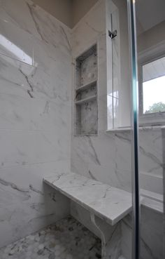 Master Shower with bench seat and custom nitch in master shower wall.