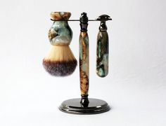 This style shave set was made with 'Travel to Jupiter' colored resin infused into the buckeye burl wood. Each finished piece is completely different than the last because the colors mix differently an
