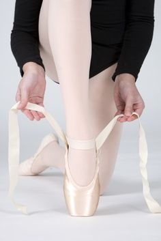 How to Tie Pointe Ballet Shoes: Hold Both Ribbons