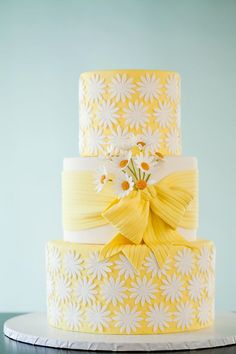 40 Chic Sophisticated Wedding Cakes - MODwedding | Round Three Tier Wedding Cake, Ultra Precious Yellow & White With White Appliqués, Yellow Bow Middle Tier Along With Sugar Flowers (Chamomile Daisies)