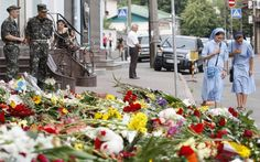 This photo shows the flowers that were placed in front of the Netherlands's Embassy in Kiev, Ukraine.