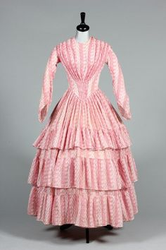 A printed muslin day dress, circa 1855, with gathers