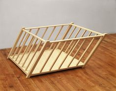 Robert Gober, Tilted Playpen, 1987, wood and enamel paint, 22½ x 45 x 45 inches.