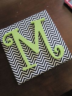 "Previous pinner says, ""Love this! Looks so easy too.  Canvas covered in pretty fabric with a big wooden letter glued on.  My daughter would love this for her dorm! So perfect."""