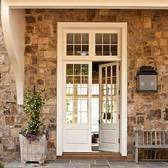 Love this stone and transom door. Best New Home | Old-House Soul | SouthernLiving.com