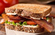 The BLT is a simple sandwich, but simplicity demands excellence. Each component plays an important role, and maximizing the crisp saltiness of the bacon, the crunch of the lettuce, and the juicy sweetness of the tomatoes is what makes the sandwich … Mozzarella Sandwich, New York Times Cooking, Toaster Oven Recipes, Plain Bagel, Marinated Tomatoes, Lard, Cheese Spread, Pasta, Sandwich Recipes