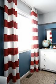 red or gray striped curtains against blue accent wall.