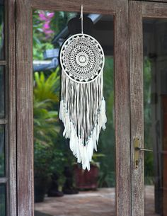 Large White Dream Catcher - Express shipping to US Large handmade dream catcher crocheted into a beautiful white mandala. Dream catcher is made with a bamboo whoop, wrapped in white suede, crocheted web and ends with suede fringes and white feathers. Calming addition to your