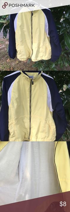 Wilson Lightweight Athletic jacket A lightweight soft yellow & blue. GUC Wilson jacket. Two front zippered pockets. Nice Lining inside. Wilson Jackets & Coats