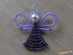 Slíbila jsem Marcelce, že vložím návod na andílka z korálků. Tak tady je :-)<br>Použila jsem drát 0,...