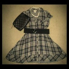 Cute  short plaid dress Black and white plaid dress. Has pockets, buttons down the front. Come almost 5 inches above my knee mind code Dresses