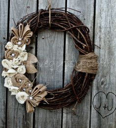 Rustic burlap and ivory wreath.