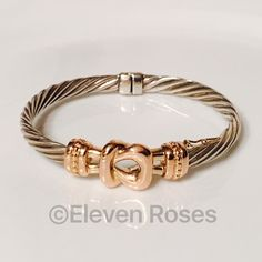 """Sterling Silver & 14k Gold Cable Buckle Bracelet Designer Alwand Vahan Sterling Silver & 14k Gold Cable Buckle Bangle Bracelet - 925 Sterling Silver & 14k Gold - Bangle Measures Approx 2.5"""" X 2"""" X 6mm - Gold Buckle Measures Approx 15mm X 34mm - Weighs Approx 32 Grams - Alwand Vahan Hallmarked; 925, 14k - Gold Buckle Has A Slight Pink Hue (is not bright yellow) Alwand Vahan Jewelry Bracelets"""