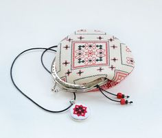Folk coin purse, metal frame purse, cross stitch pouch, cosmetic purse, ethnic ukrainian embroidery, hand embroidered, red, boho  You will get folk purse EXACTLY as shown on photos. It is ready to ship! This listing is for the purse AND AS A GIFT YOU GET CROSS STITCH PENDANT!  Ukrainian folk embroidery is ethnic folk greeting for good life! Traditional embroidery gets modern touch and becomes beautiful and handy use. This one embroidery if from Lugansk region in Ukraine. Front part with…