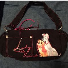 Lady and the Tramp Purse Also bought from Disney World in 2011. Ended up never using it and just saw it as a souvenir. I do not have the room or need for it anymore so I'm just trying to sell! It is in perfect condition- no stains, tears or rips! Disney Bags Shoulder Bags